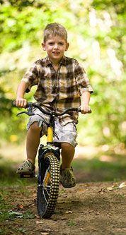 Asigura-i copilului tau protectia pe bicicleta