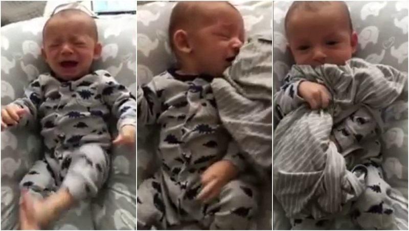 VIDEO. Un tata reuseste sa-si calmeze copilul care plange dupa ce ii da un tricou purtat de mama sa
