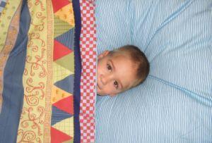 Trecerea copilului de la patut la pat